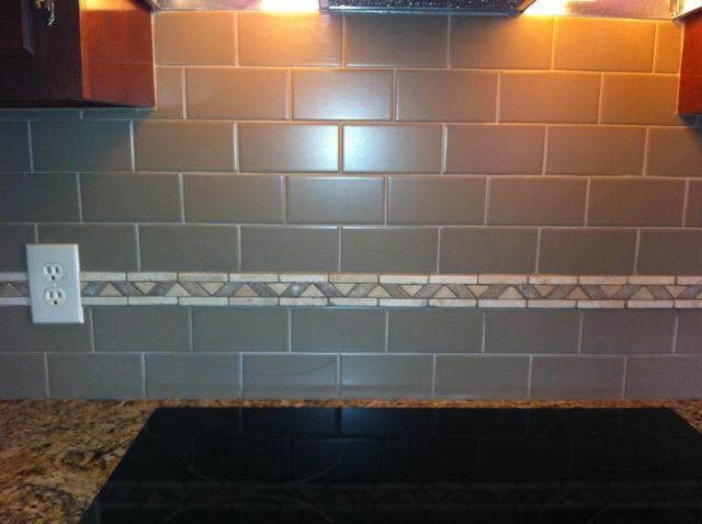 Matte Finished Subway Tile Backsplash With Tumbled Stone Border Black Countertops Home Remodeling Grey Subway Tiles