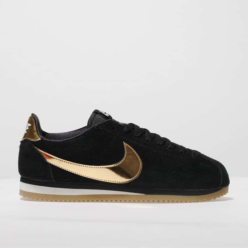 gold nike cortez suede trainers