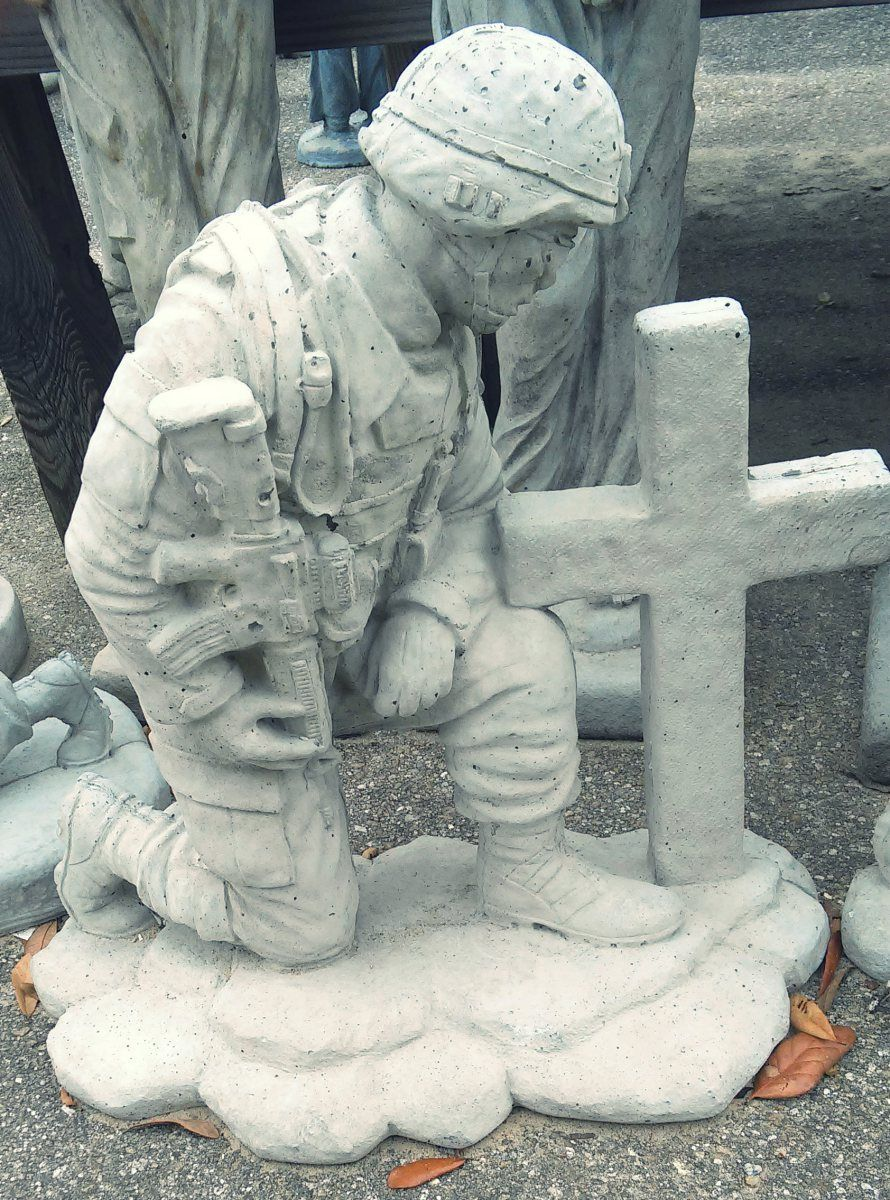 Soldier kneeling at cross concrete garden art in for Landscaping rocks tallahassee