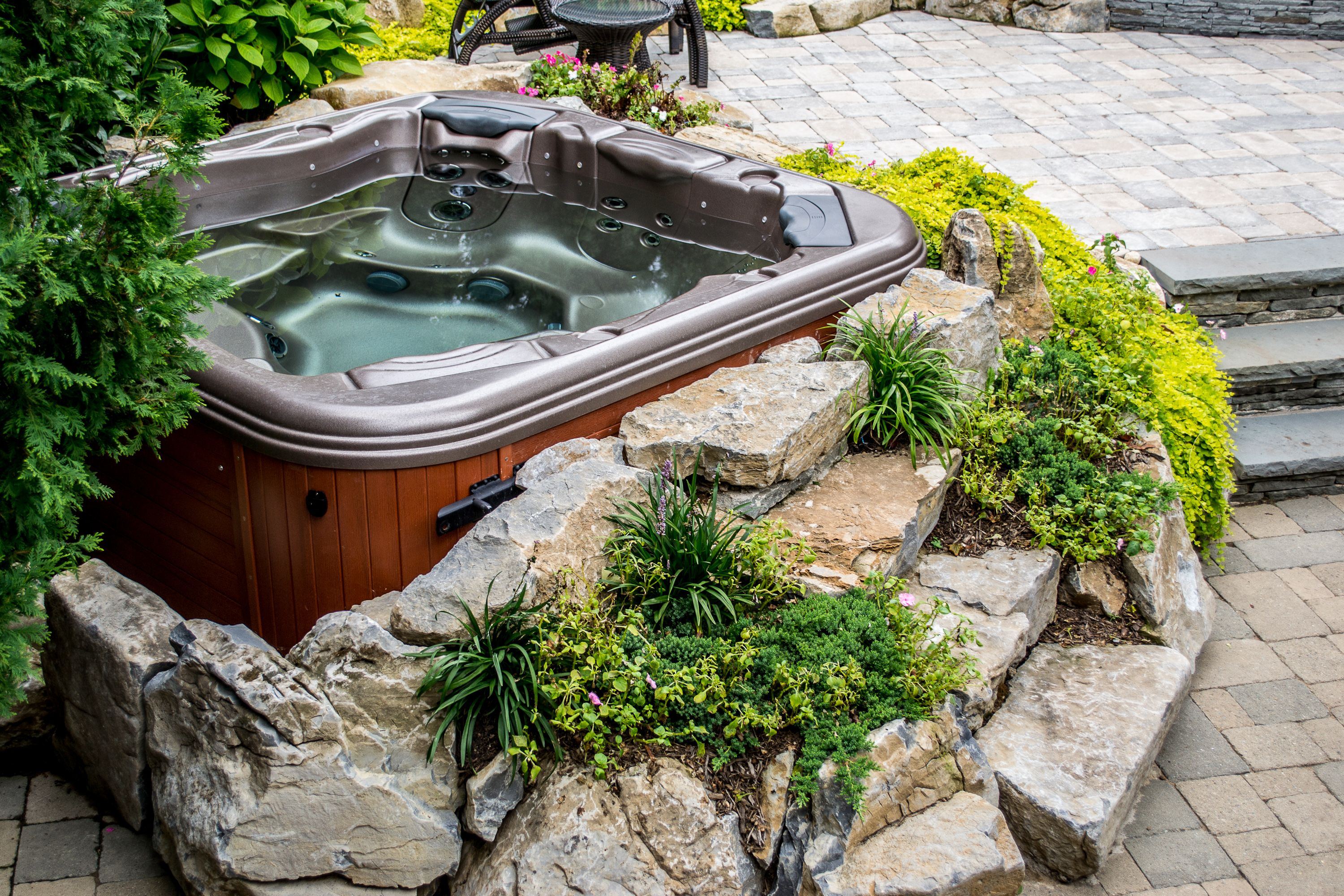 Hot tub landscaping ideas bullfrog spas long island hot for Garden design ideas hot tubs