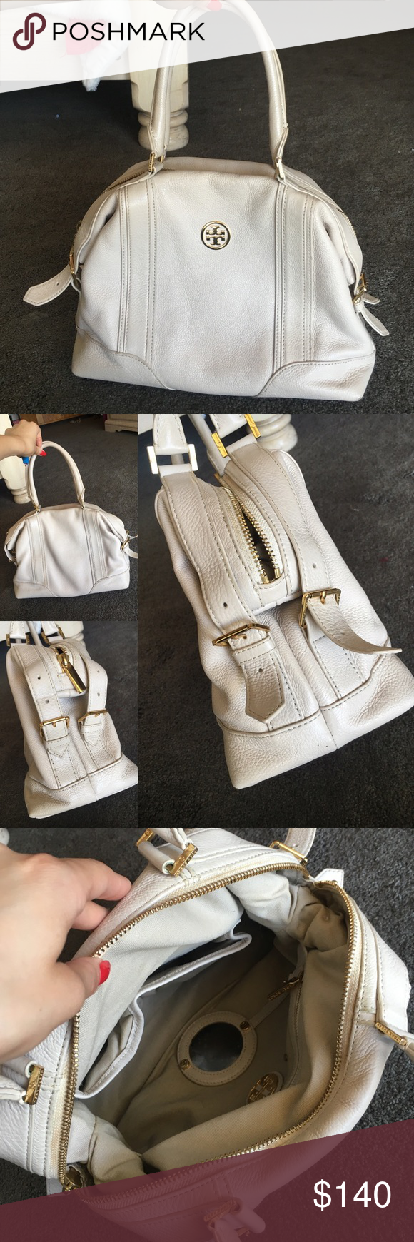 Tory Burch ivory cream handbag In great condition. No stains. Mirror inside with protective sticker still on. Second pic shoes the side buckes you can adjust for a different look. Each side has 2 buckles and one side has a small leather piece missing, not noticeable look at second pic. Tory Burch Bags Satchels
