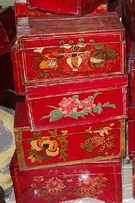 Painted wood boxes with delicate emblems