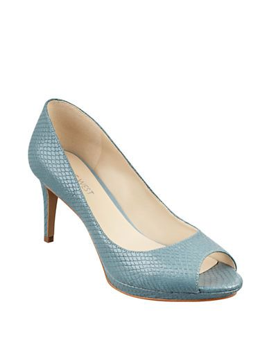 "<ul> <li>Timeless pumps in a high-contrast geometric motif</li> <li>Self-covered heel, 2""</li> <li>Leather upper</li> <li>Peeptoe</li> <li>Rubber sole</li> <li>Padded insole</li> <li>Imported</li></ul>"