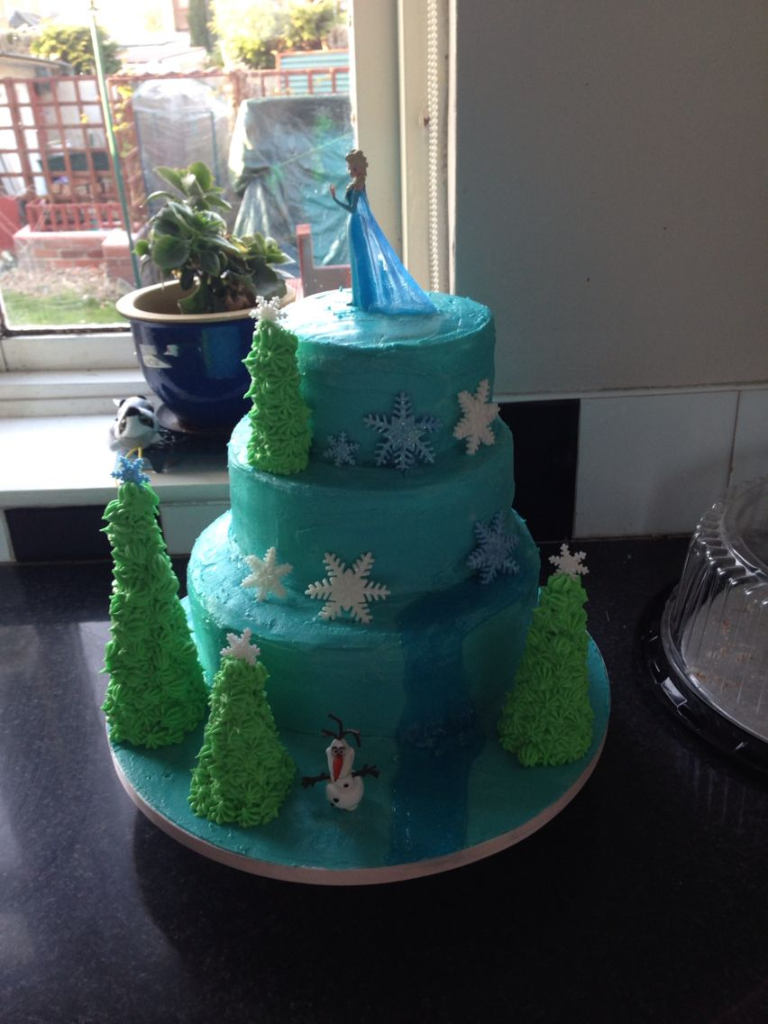 First go at decorating a tired cake with the frozen theme.