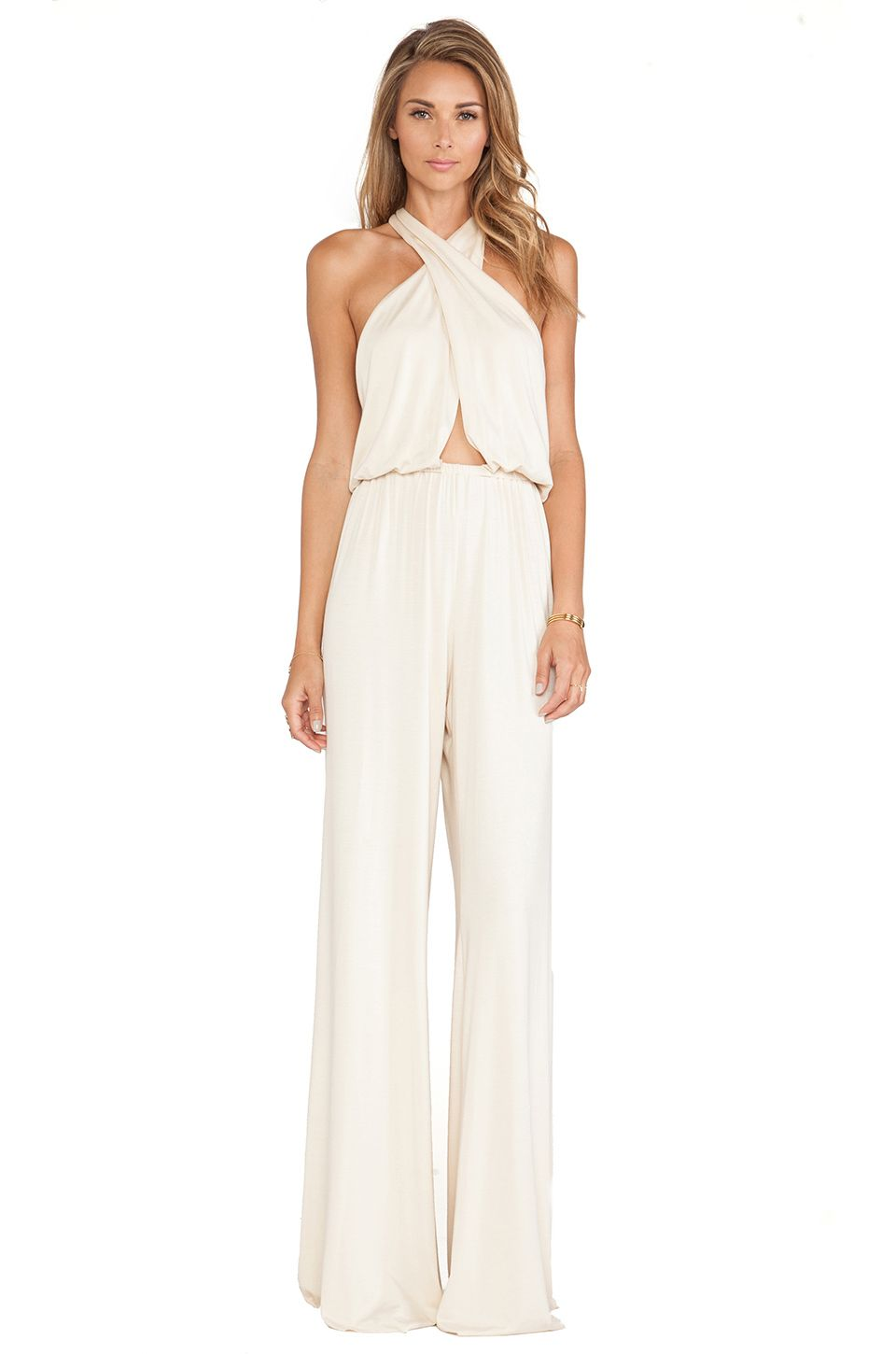 656990ad9dc  REVOLVEclothing austin jumpsuit in cream or black by rachel pally 242  criss cross halter with a little cutout near midriff wide leg flowy