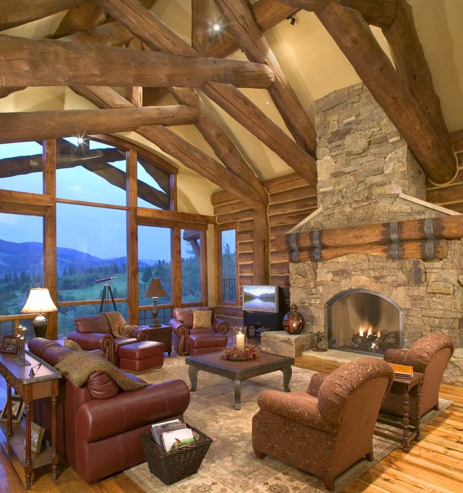 Great Northern Lodge Rustic Timber Frame And Stone Bedroom: Log Trusses And Stone Fireplace In