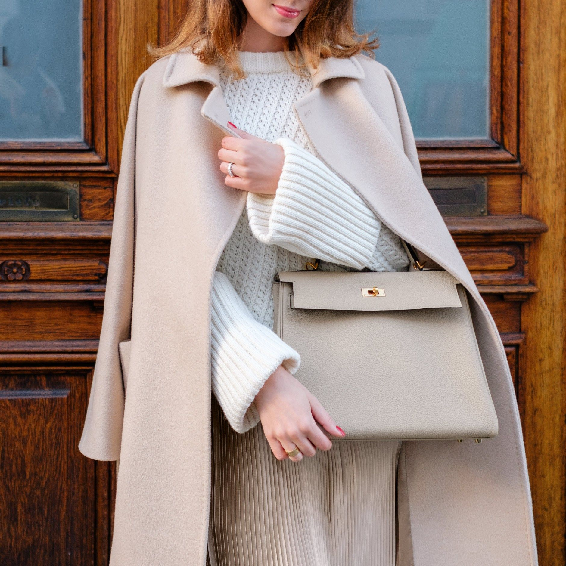 Wearing Hermès Kelly Bag in color Trench (size 32) and Max Mara Lampo coat 978c0a25caae6