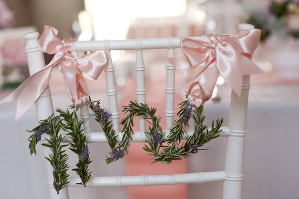 Mr. & Mrs. signs made from lavender that were put on the back of our chairs