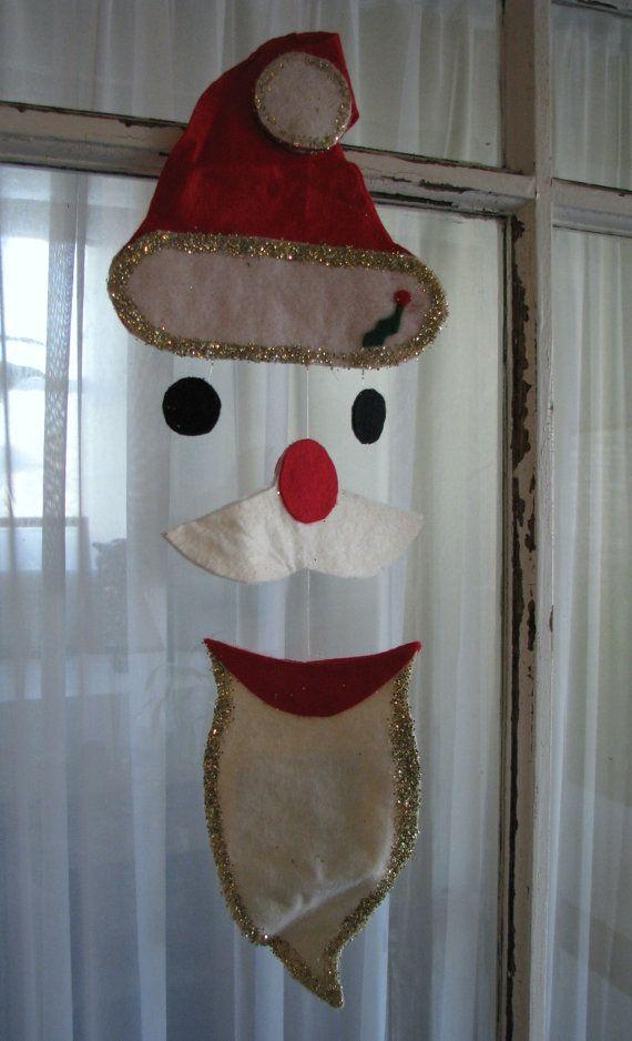 Vintage Felt Santa Mobile. $5.00, via Etsy.
