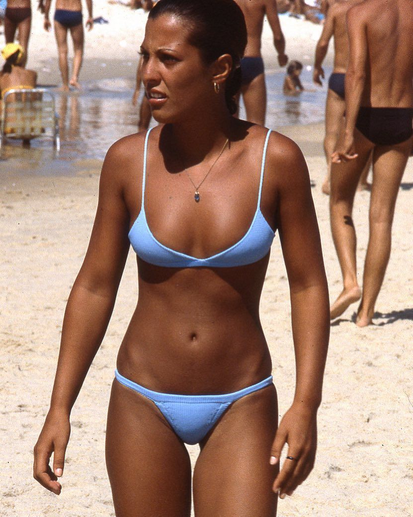 Rio de Janeiro, Brazil. Two women in bikinis on Ipanema