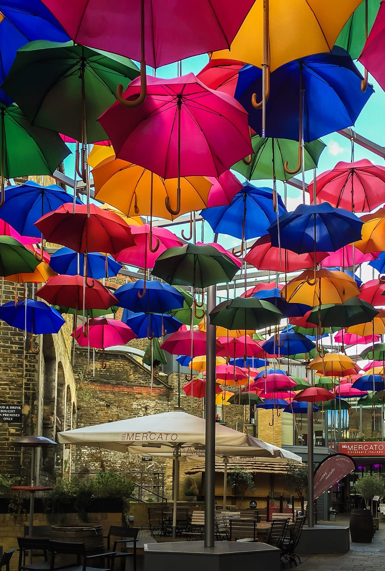 Colourful display of suspended umbrellas near Borough Market, London.