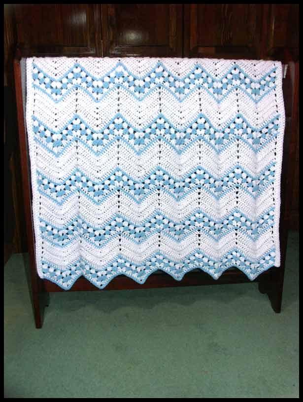 "Romance Baby Boy's Blanket, 35.5"" x 45"", $65."