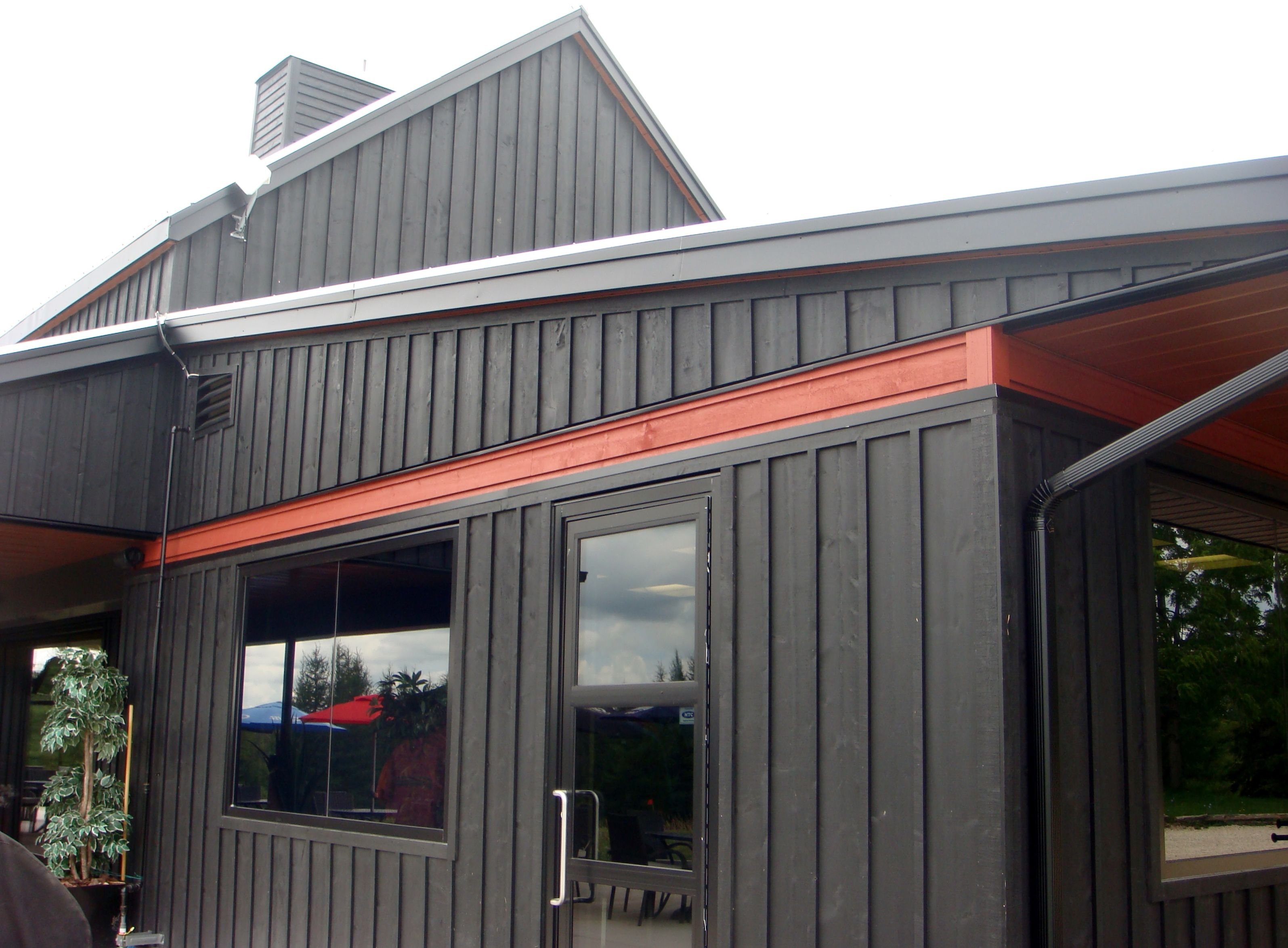 Board Batten Siding With Aluminum Soffit Fascia And Trough