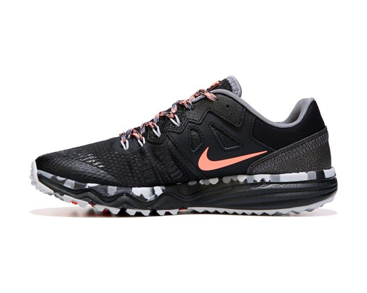 b500b93306034 Tear up the trail in the Dual Fusion Trail 2 Trail Running Shoe from Nike.Lightweight  mesh low cut upper in a trail running shoe styleLace up frontNike ...