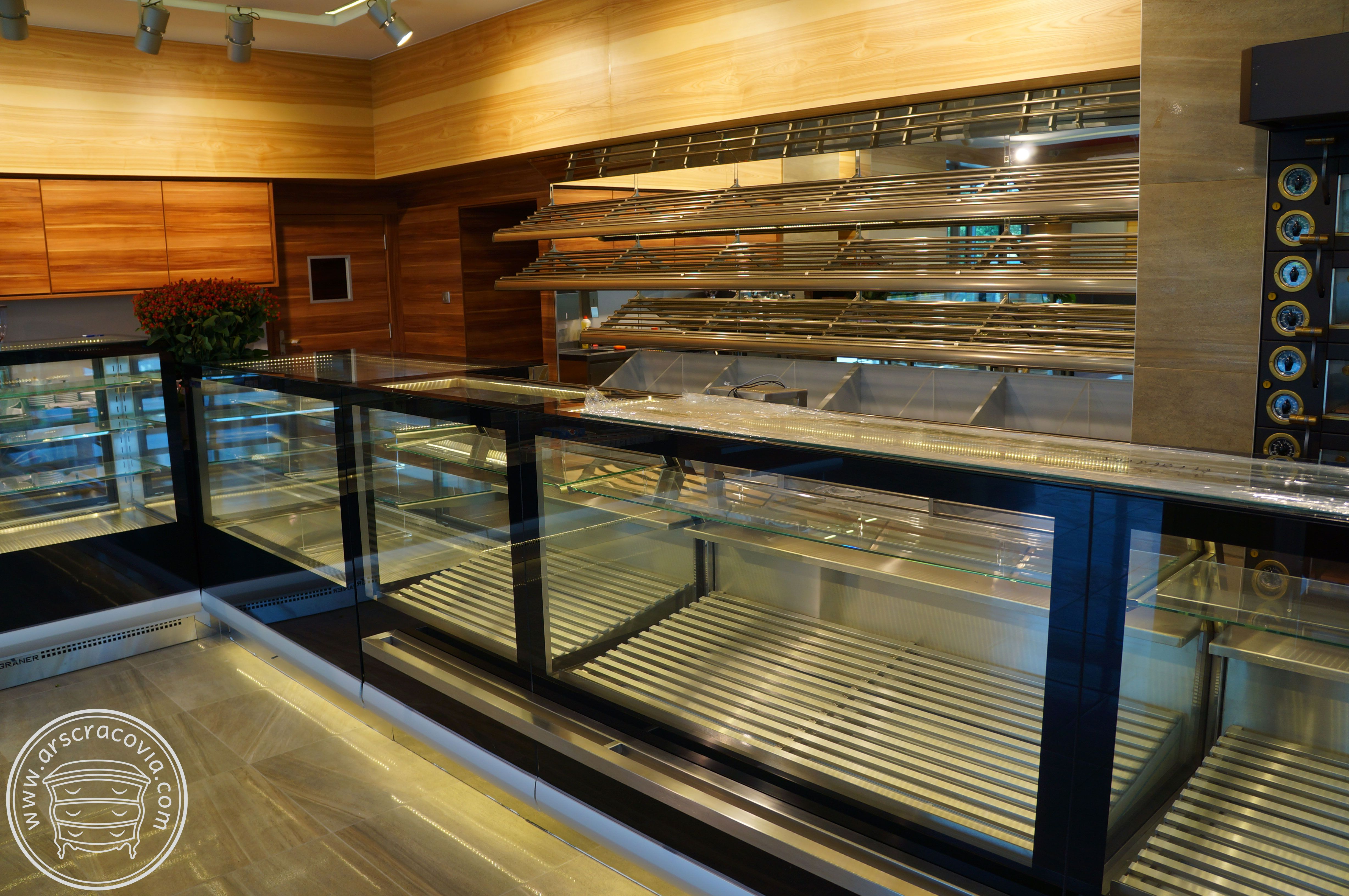 Steel illuminated bread shelves with bread boxes, …