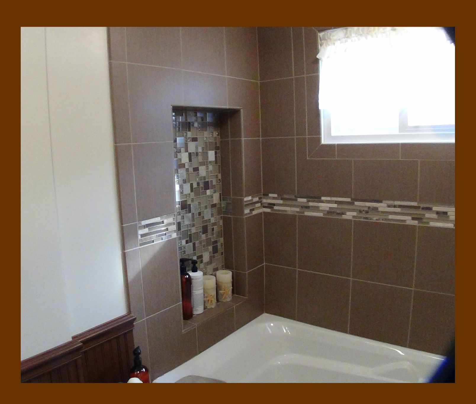beautiful tiled alcove for candles or shampoo above large soaking ...