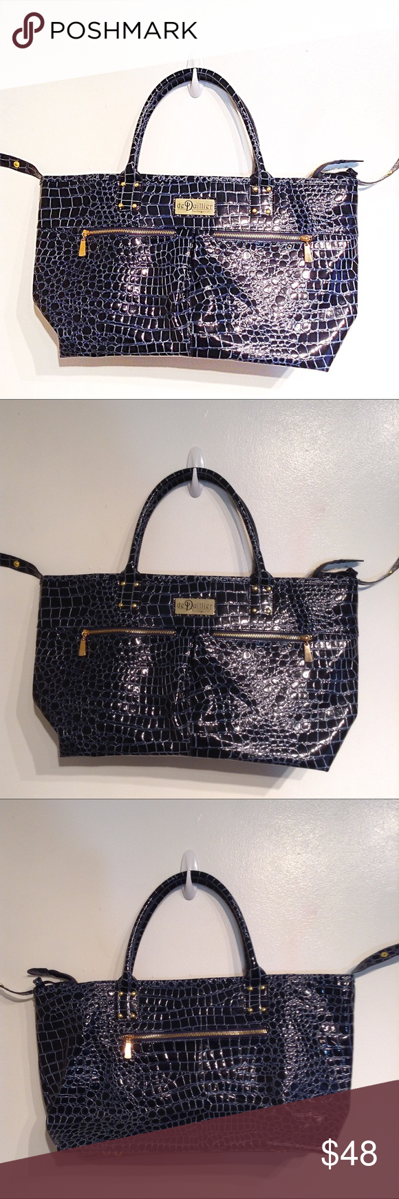 """DE DUILLIER HERITAGE 1704 Large Croc Skin Tote de Duillier Heritage 1704 patent faux leather croc/snakeskin textured tote bag. Huge and roomy. Zips shut. Zippered pockets on front. Would make a great large purse, diaper bag, weekend bag, or work/school tote. Measures 20"""" wide across the top and 11.5"""" tall. No modeling. Smoke free home. I do discount bundles. de Duillier Bags Totes"""
