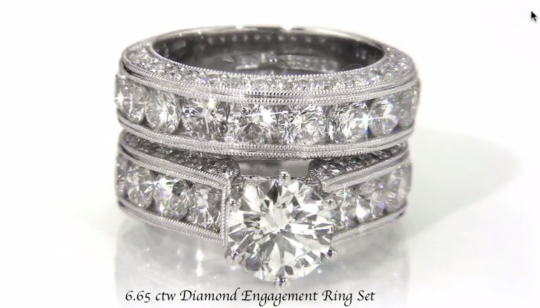 Enormous 6.65 ctw Round Diamond Engagement Ring Set with custom Hand-Engraving and matching wedding ring.    Channel set round accent diamonds are .25 carat each!