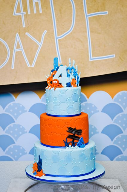 Photo 2 of 37: Under the Sea 3 tiered cake.  love the pressed fondant to look like bubbles.