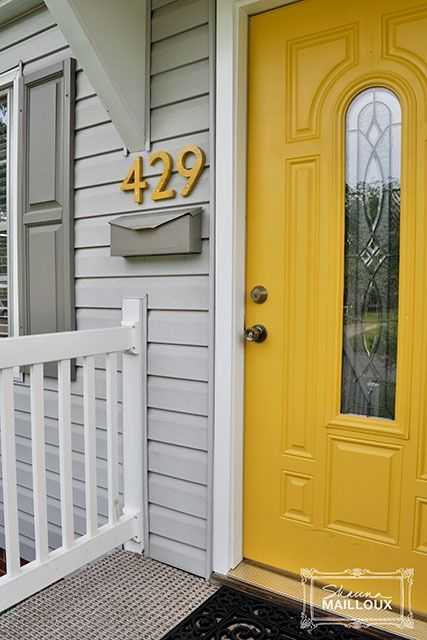 This Makes Me Want To Re Paint All Of Our Doors The Yellow Gold Looks Gorgeous With The Gray Siding Exteriordoor Plywood House House Exterior House Numbers