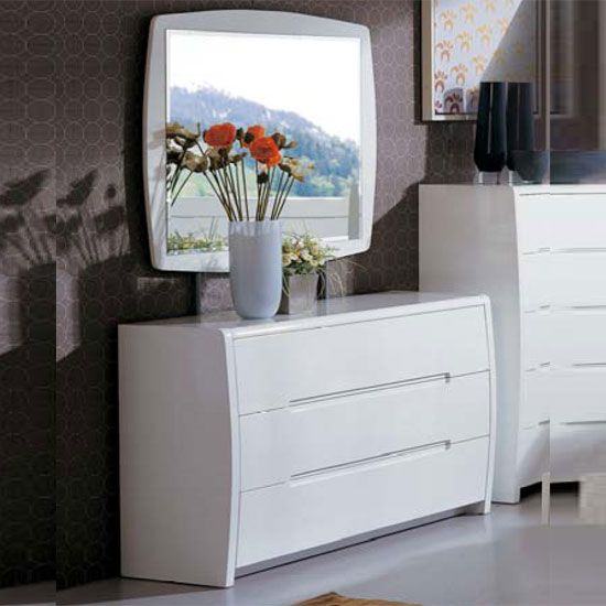 Observe a beautiful combination of a chest and a mirror in this The chest  has 3 drawers and is furnished in white gloss shade  The features a white  boundary. Observe a beautiful combination of a chest  drawer and a mirror in