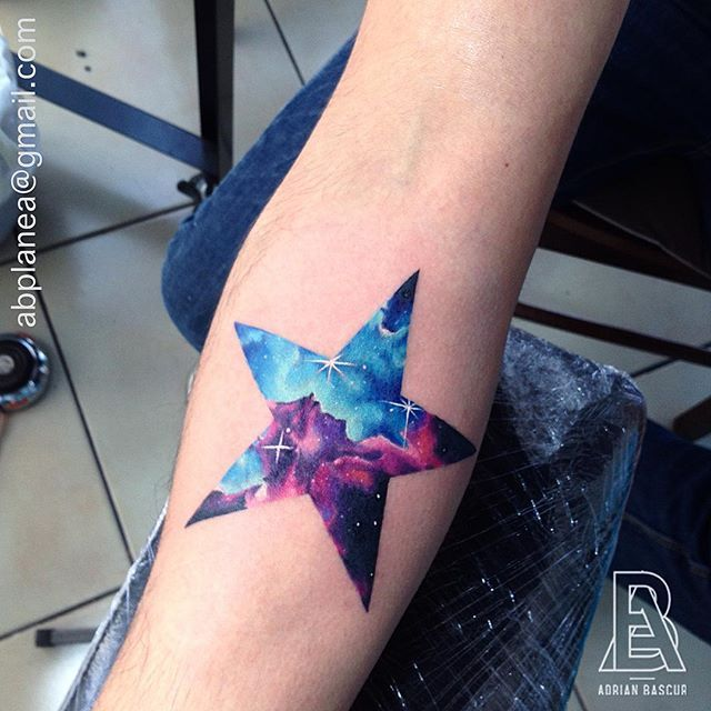 Fantastic Forearm Space Piece In The Form Of A Star With A Colorful Space Scene In The Background Star Tattoos Star Tattoo Designs Tattoos