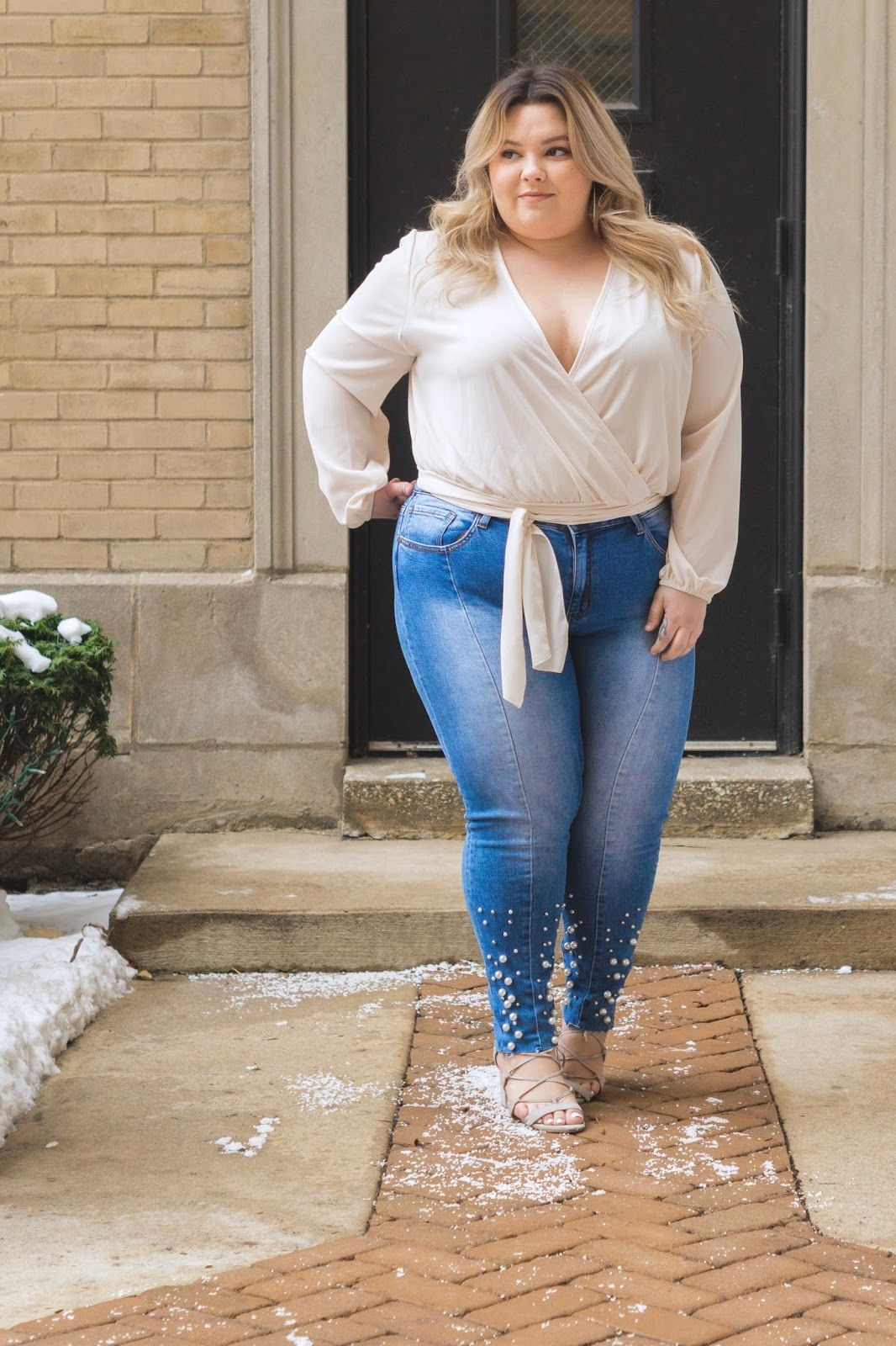 c2e78706f43ef Chicago Plus Size Fashion Blogger Natalie Craig reviews Fashion Nova  Curve s little white lies wrap top and private jet high rise skinny jeans.
