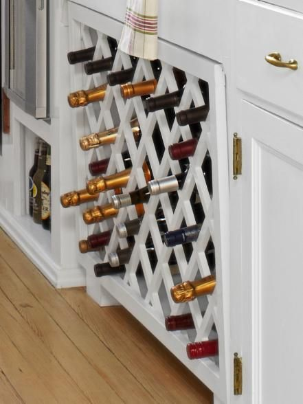 In place of a pair of cabinets, a built-in wine rack sits on…