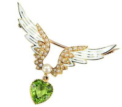 15k yellow gold, white enamel, natural seed pearls, and a heart shaped peridot, circa 1900