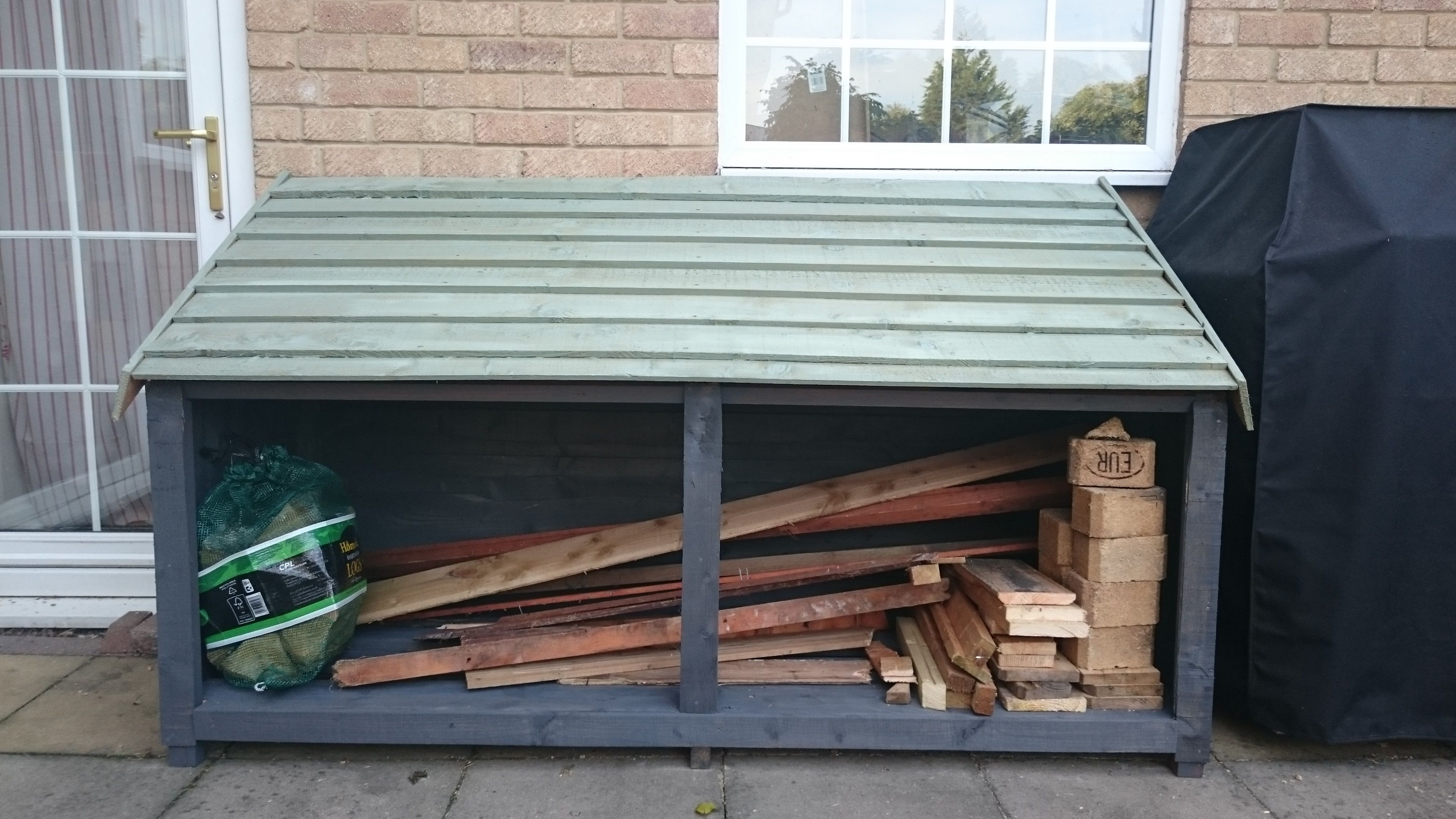 New wood store - built from unused fence panels and recycled pallets