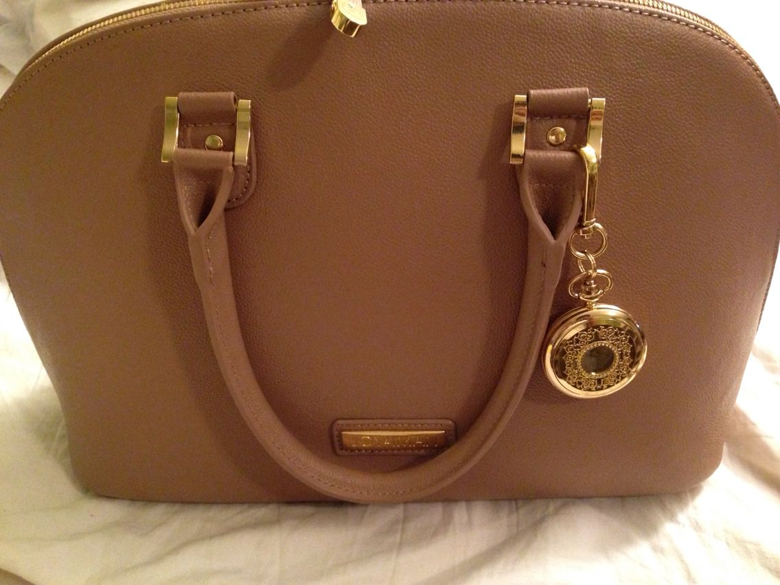 Joy and Iman handbag with a watch and built in compartments that