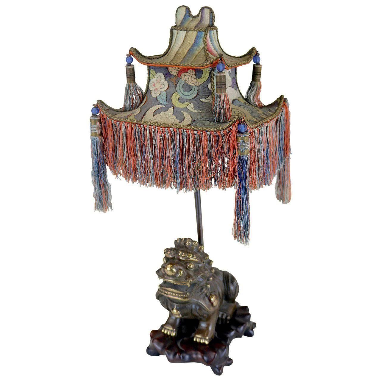 Rare exotic 1920s chinoiserie lamp of tasseled pagoda shade with foo rare exotic 1920s chinoiserie lamp of tasseled pagoda shade with foo dog base arubaitofo Choice Image