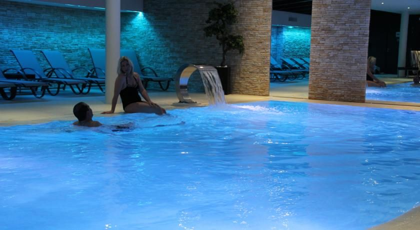 ... Hotel Au Nid De Cigognes Is Located In The Heart Of Alsace, 5 Minutes  Away From Colmar, Ribeauville, Riquewihr And Kayserberg. It Offers An Indoor  Pool, ...