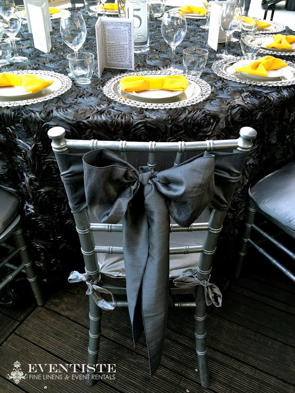 Pewter Splendor Linens, Silver Chiavari Chairs w/ Silver Satin Cushions, Silver Taffeta Sashes, P. Yellow Napkins by Eventiste.