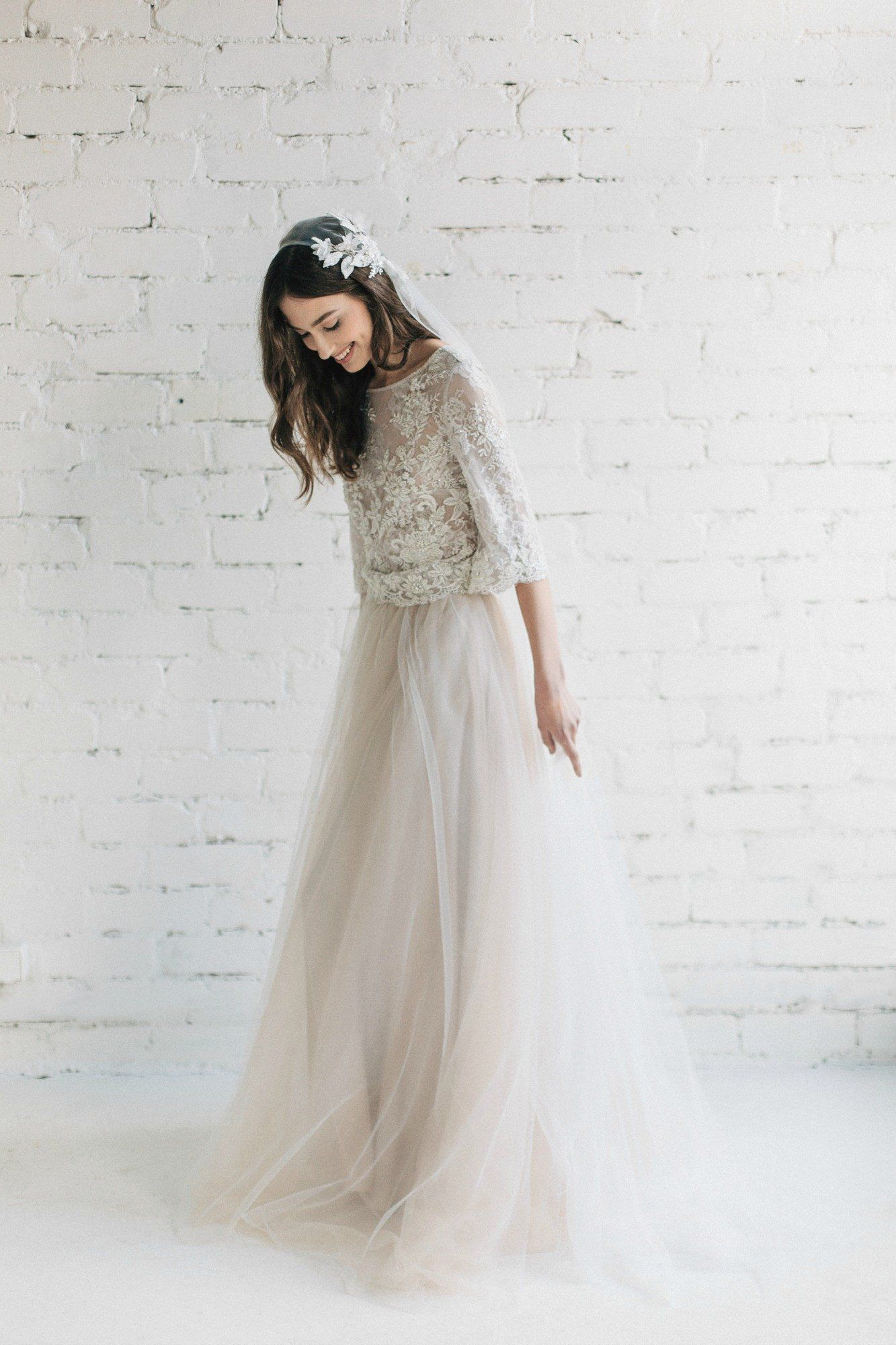 Lacey wedding dress with transparent accents and a wide flowy skirt