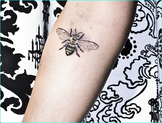 Red Lily Flowers And Bee Tattoo