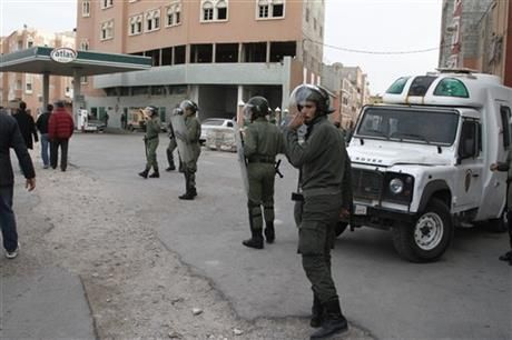 In this photo taken Tuesday, Dec. 10, 2013, riot police watch protesters in Laayoune, the capital of the disputed territory of Western Sahara during a demonstration calling for the territory's independence. (AP Photo/Paul Schemm) ▼1Jan2014AP|Tensions high in Western Sahara despite new plan http://bigstory.ap.org/article/tensions-high-western-sahara-despite-new-plan #Laayoune