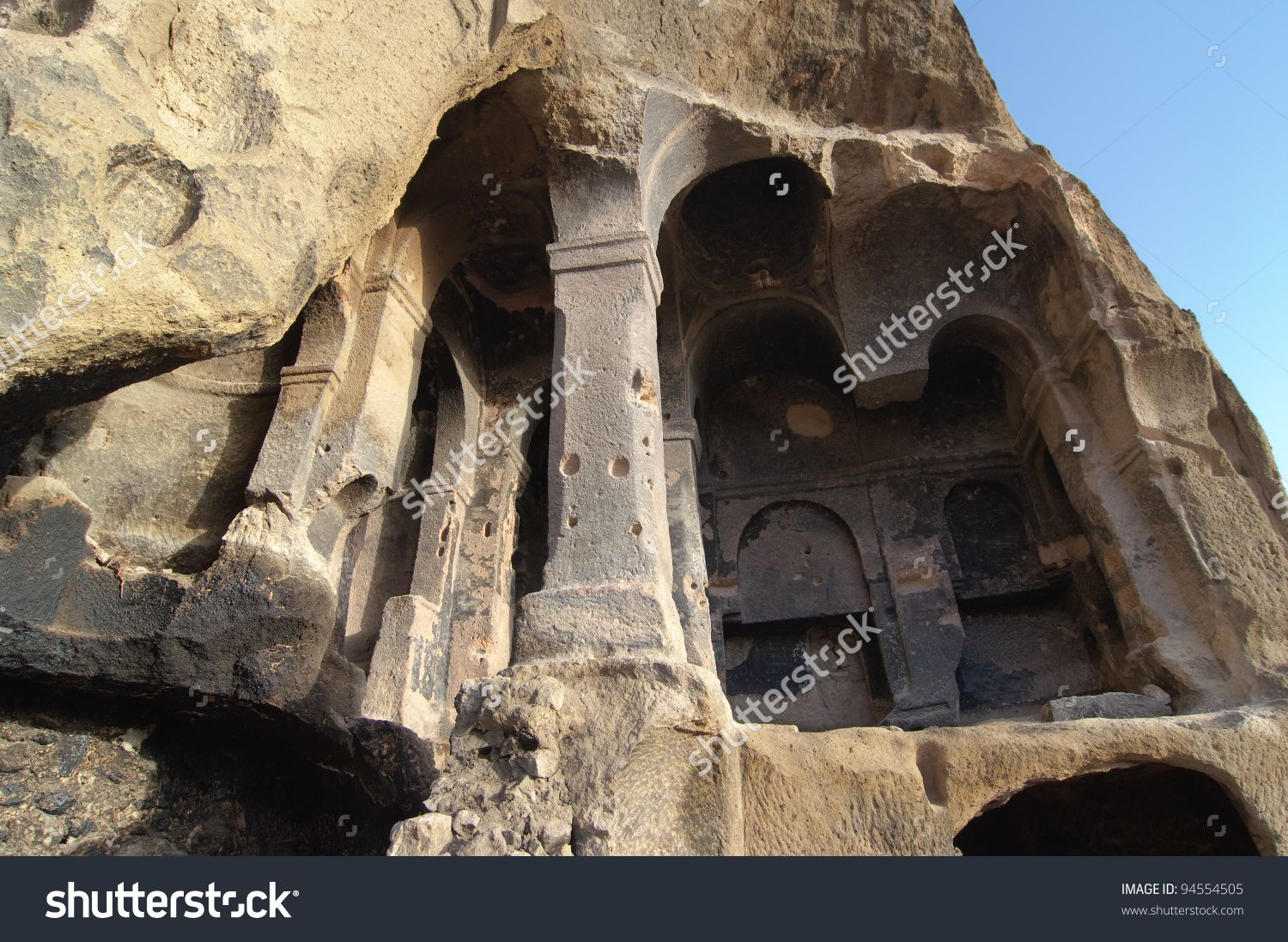 stock-photo-the-collapse-of-the-cavity-shows-the-interior-columns-carved-in-the-rock-of-a-cave-church-in-94554505.jpg (1500×1097)