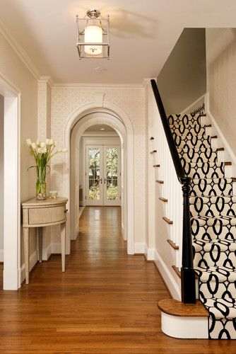 entry with traditional staircase & geometric pattern carpet #entry #staircase