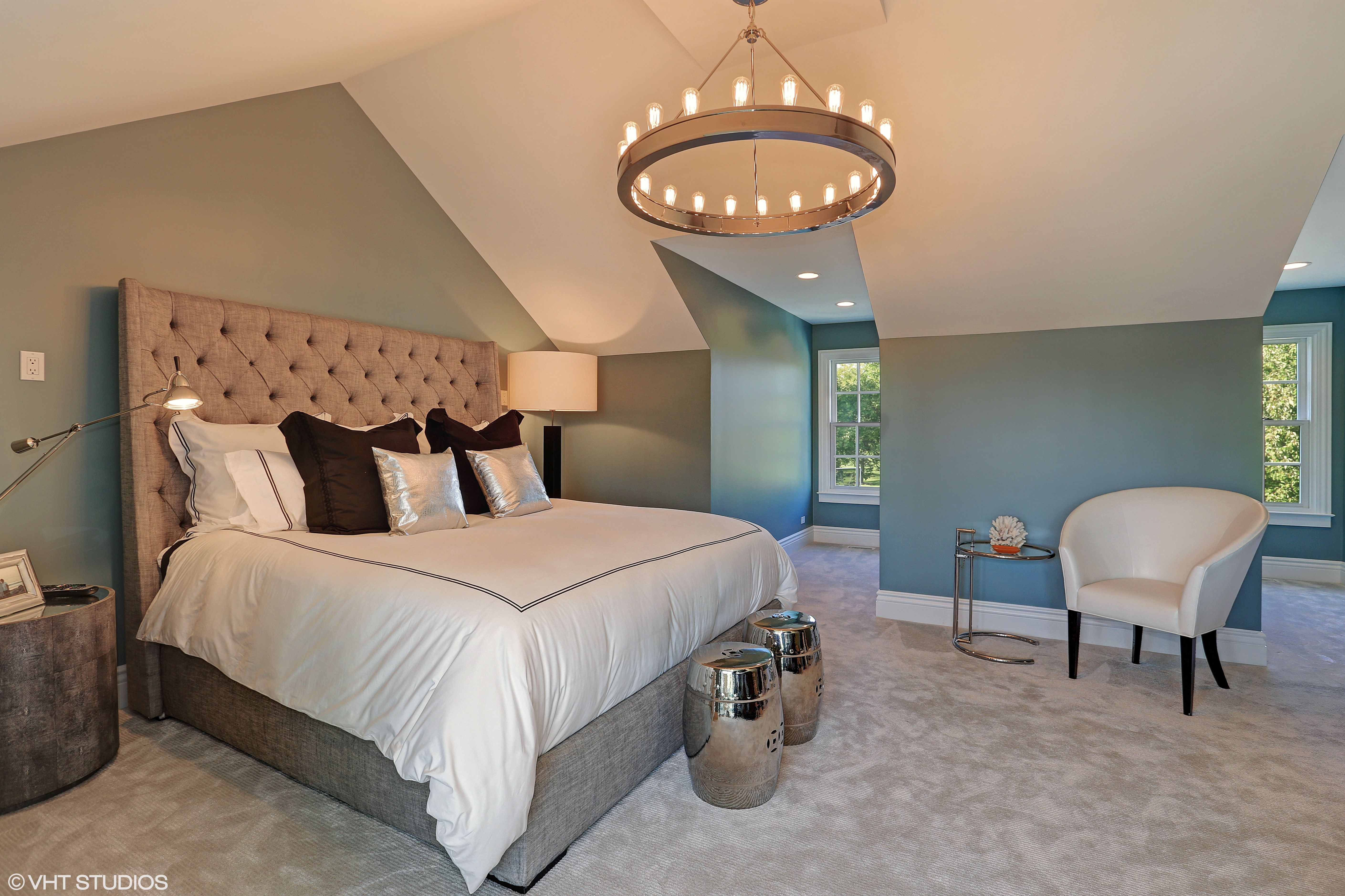 The rustic chandelier in this bedroom gives this bedroom a ...
