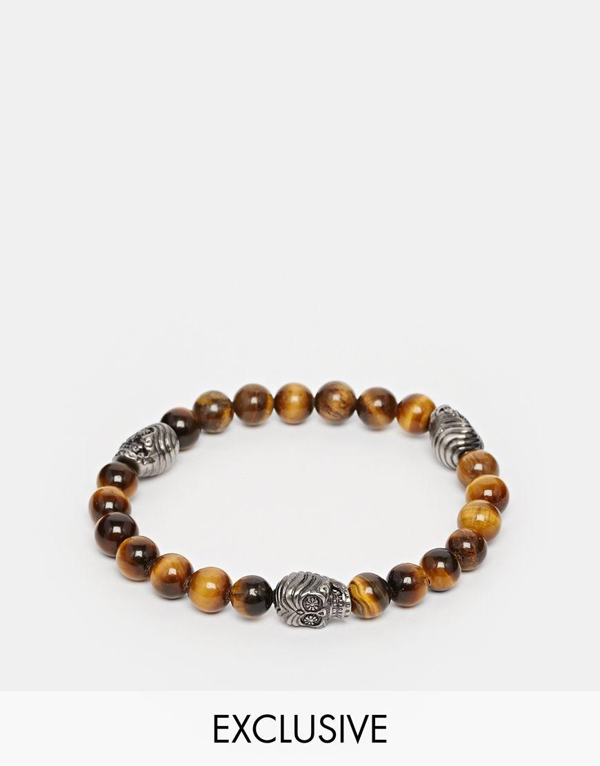 Bracelet par Simon Carter Bracelet de perles élastiqué Breloques argentées motif tête de mort gravé Taille réglable Modèle à enfiler 100% laiton Exclusivité ASOS
