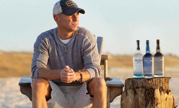 kenny chesney blue chair bay hats belmont salon parts rolls out rum with 18 city party series