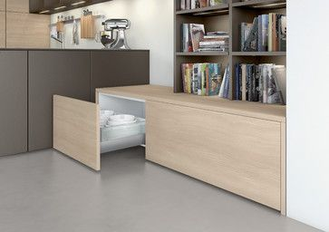 Library, living or dining room? This homely and modern arrangement is recognisable as a kitchen only at second glance.
