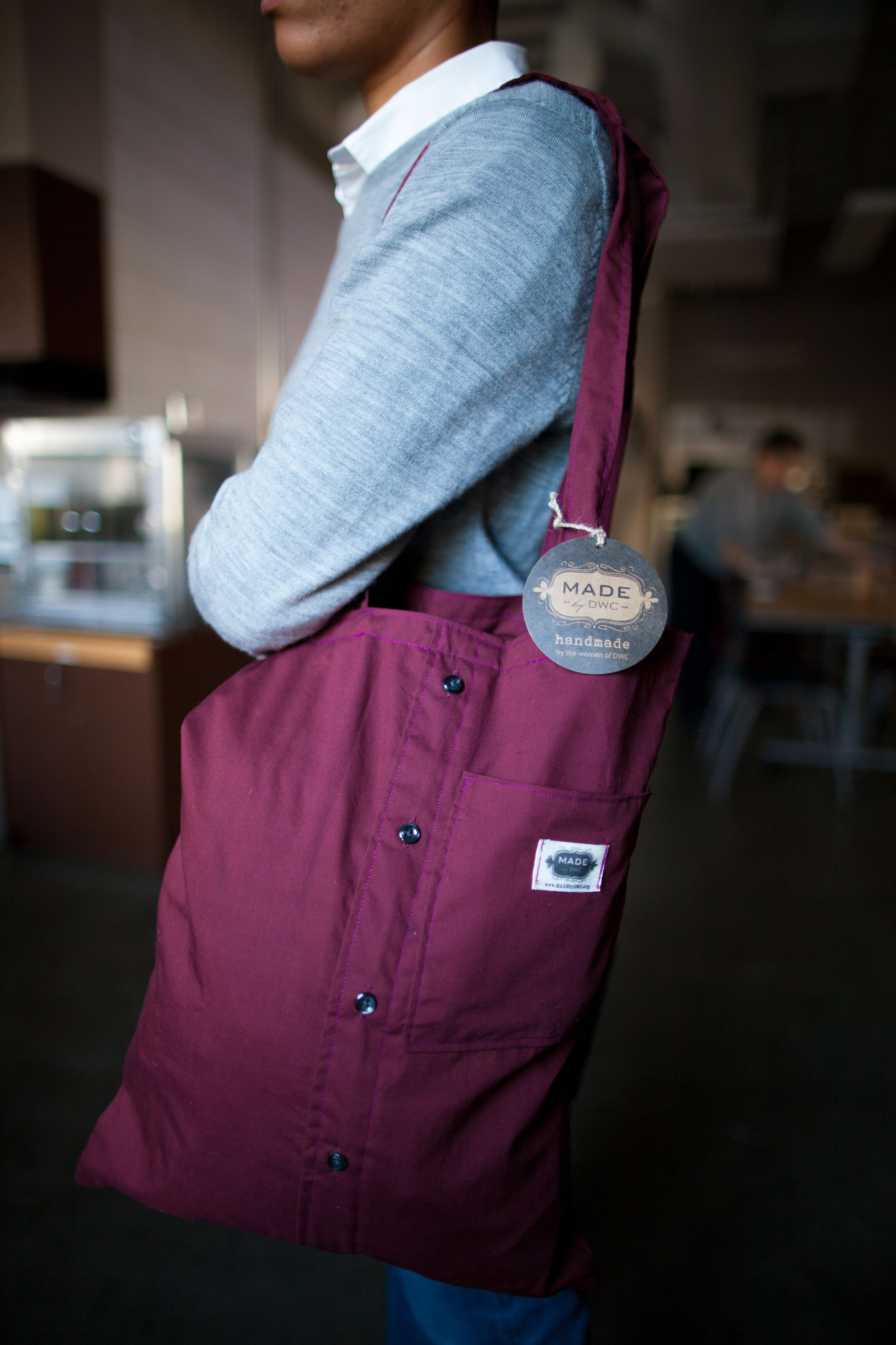 Check out our BRAND NEW reclaimed shirt bags! Sling one over your shoulder and carry your notebooks or wallet in this soft but durable bag handMADE by the women of DWC! www.madebydwc.org