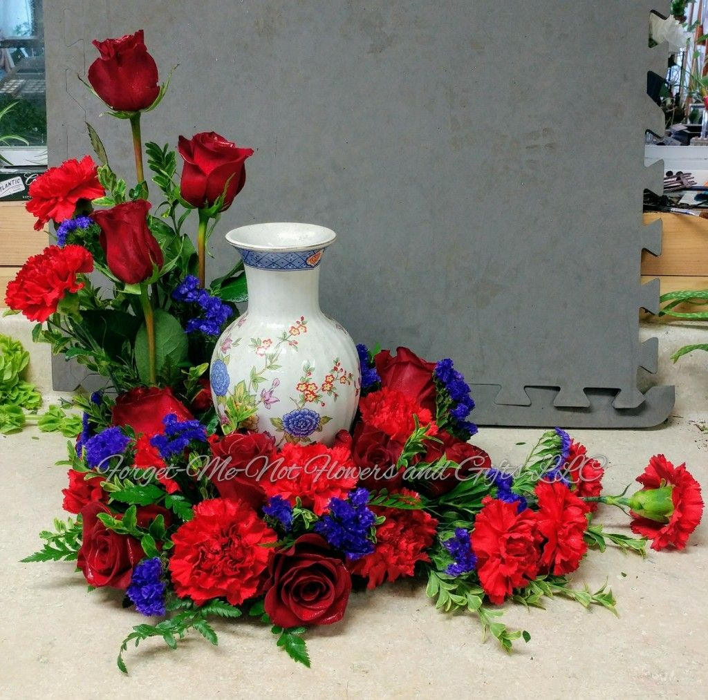 Red and Purple urn wreath with roses, statice, and