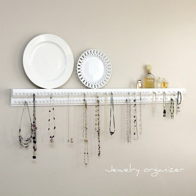 DIY Jewelry Organizer hang necklaces from upholstery tacks use