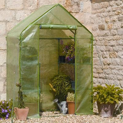 "Compact Walk-in Greenhouse is ideal for limited spaces, Shelving included, Includes wall fixing rings and guy ropes. 4' 8"" deep x 4' 8"" wide x 6' 5"" high. – MobiNetTel"