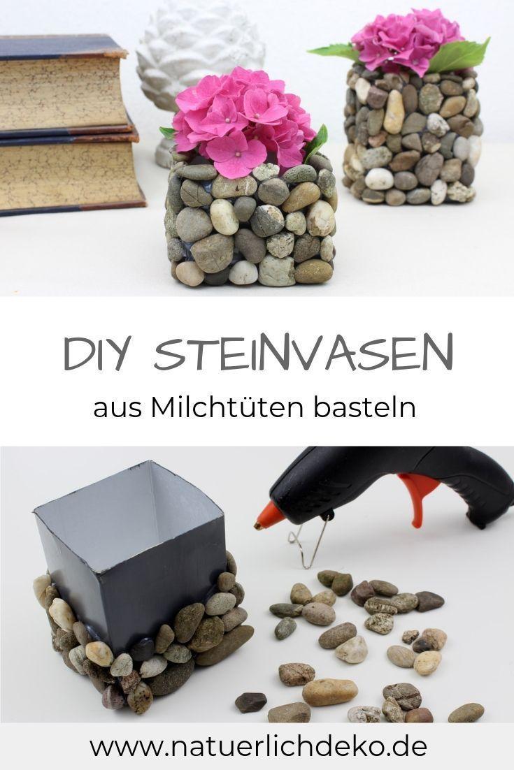Milchtüten DIY: Blumenvasen mit Steinen