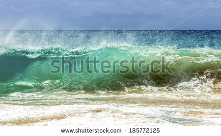A wave breaking on the shore of Sandy Beach on Oahu, Hawaii