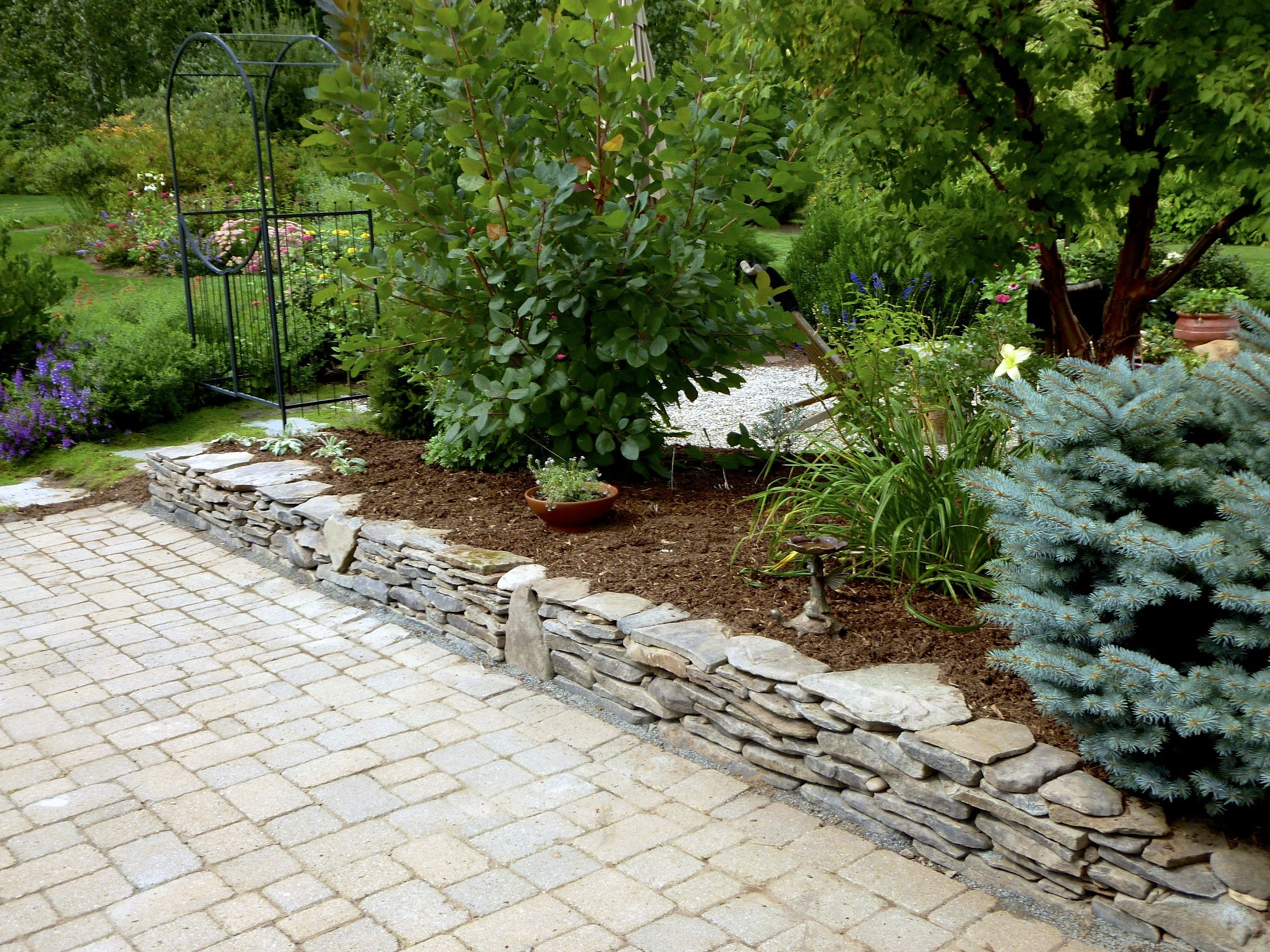 Dry Stacked Stone Wall I Built This With One Pallet Of Field Stone No Mortar Raised Garden